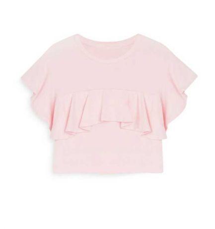 Camiseta rosa con volante de niña peque 4,00€